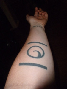 tattoo of spiral of potential energy